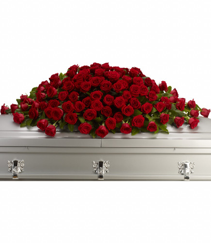 Greatest Love Red Rose Casket Spray from Enchanted Florist. A loving embrace of rich, regal roses in an all-red spray to adorn the casket. Eight dozen red roses are pictured in this sympathy casket cover spray. RM564