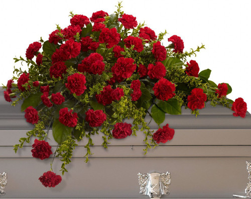 Adoration Red Carnation Casket Spray from Enchanted Florist. This classic half-couch spray of brilliant red carnations makes a striking and dignified statement. Radiant red carnations and miniature carnations accented by fresh greenery arrive in a lovely spray. 3 dozen red carnations. RM570