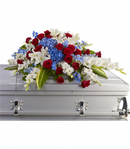 Distinguished Service Patriotic Red White and Blue Casket Spray from Enchanted Florist. Brilliant patriotic theme flowers such as blue hydrangeas, red roses, white oriental lilies and much more create this dignified way to honor the deceased.  RM568