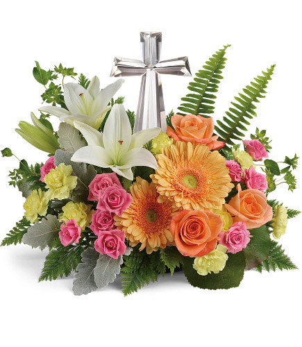 "Bright Petal Large Crystal Cross Sympathy Flowers from Enchanted Florist. Our funeral flower arrangement includes pink spray roses, white oriental lilies, light orange gerbera daisies, and yellow miniature pixie carnations and is accented with various greenery including galax leaves, sword fern, and leatherleaf fern. Delivered with the large crystal cross keepsake. Cross is approximately 11""H x 6""W x 2""D. Sympathy flower arrangement is approximately 16"" W x 13"" H SKU RM578"