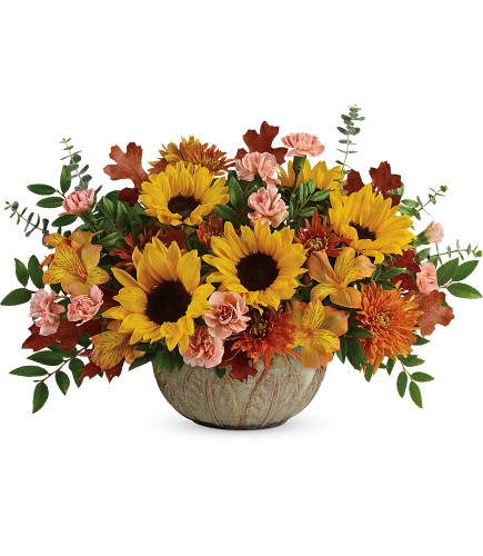 "Amazing Autumn Sunbeams Sunflower Bouquet from Enchanted Florist. Your sunny fall centerpiece features yellow alstroemeria, peach miniature carnations, medium yellow sunflowers, bronze cushions, spiral eucalyptus, huckleberry, and brown fall oak leaves. Delivered in an Artisanal Autumn Bowl. Approximately 19"" W x 13"" H SKU RM225"