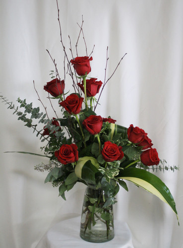 "Near and Dear to Me Red Rose Bouquet from Enchanted Florist. This gorgeous bouquet will arrive with beautiful red roses, eucalyptus, ti leaves, branches and more. Approximately 30""H x 20""W SKU 355"