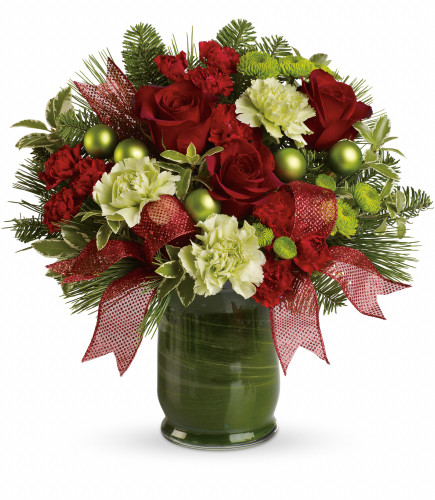 """Joy to Behold Green Carnation & Red Rose Bouquet from Enchanted Florist. Rich red roses are mixed with miniature red carnations, large light green carnations and green button mums then finished with white pine and , noble fir. The flowers are delivered in a classic glass vase that's lined with a green ti leaf for a sophisticated presentation. Approximately 15"""" W x 15"""" H SKU RM262"""