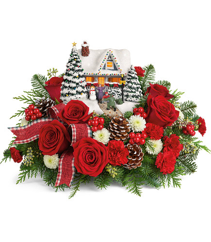 "Thomas Kinkade's Hero's Welcome Christmas Bouquet from Enchanted Florist. Home for the holidays! This holiday arrangement includes red roses, miniature red roses, white button spray chrysanthemums, seeded eucalyptus, noble fir, and flat cedar. Delivered with Teleflora's Thomas Kinkade's Hero's Welcome Keepsake. Approximately 16"" W x 10"" H SKU T20X200"