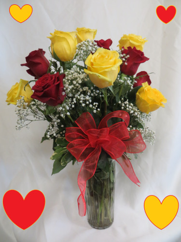 """Yellow and Red Dozen Roses for Valentines Day by Enchanted Florist  - One dozen long stems yellow and red roses are arranged in a vase with baby's breath and ribbons as pictured. Don't make you special someone design her own flowers from a box! Our beautiful Ecuadorean roses are hand designed by expert floral artisans here in our Pasadena flower shops. Red is the color of love and yellow is the color for friendship because she is your best friend too! Approximately 18""""W x 22""""H   SKU RM960"""