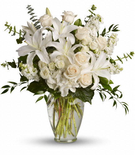 "Dreaming of You All White Arrangement from Enchanted Florist Pasadena TX. Beautiful flowers such as white hydrangea, spray roses and stock, white roses, eucalyptus and more fill a tall glass vase. Approximately 25"" W x 25"" H. For local delivery only. SKU RM118"