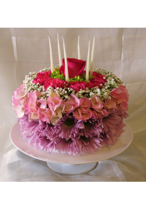 Beautiful Birthday Cake of Flowers from Enchanted Florist - This beautiful birthday cake of flowers will light up any birthday girl's face, with out adding any pounds! Includes lavender daisies, hydrangeas, baby's breath, pixie carnations, and a rose on a cake stand. Yes! Cake stand and candles are included. SKU RM141