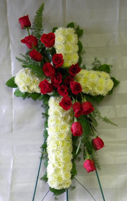 """Love and Honor Red Rose Funeral Cross by Enchanted Florist - Red roses symbolize your love, while the cross symbolizes honor. So honor the one you love, one last time with this beautiful and special funeral cross of sympathy flowers. Eighteen red roses make this an eye catcher. Roses are available in other colors if request such as pinks, white, yellow, or lavenders. Please call our flower shop for any special requests. Approximately 26""""W x 40""""H.  SKU RM509"""
