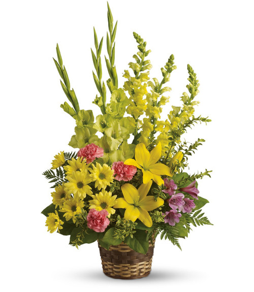 Vivid Memories Yellow Sympathy Flower Basket by Enchanted Florist Pasadena TX. Sympathy flowers in a funeral basket with yellow gladiolas, yellow snap dragons, yellow lilies, and pink carnations. Order flowers online for same day delivery in sympathy flowers in Houston TX. RM529