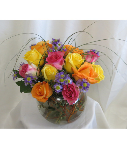"""Tropical Paradise Bowl of 15 Roses by Enchanted Florist TX. Rose colors can vary but pictured are yellow, hot pink, and orange.  A wonderful bouquet to celebrate any occasion!  Approximately 12""""H x 12""""W  **15 roses in a bowl SKU RM360"""