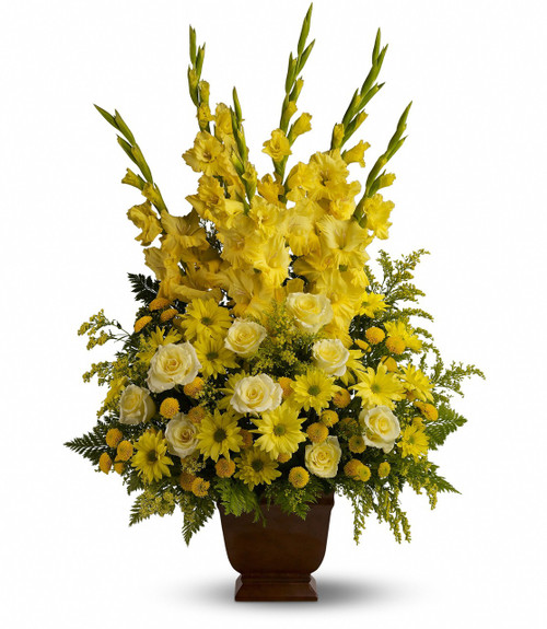 Sunny Memories Yellow Funeral Flowers by Enchanted Florist Pasadena TX. All yellow funeral flower arrangement of bright sunny flowers including yellow gladiolas, yellow roses, yellow daisies and in a brown funeral urn. RM530