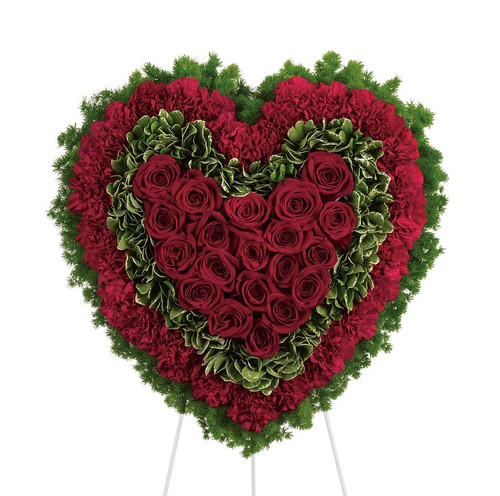 """Majestic Red Rose Sympathy Heart Funeral Flowers by Enchanted Florist Pasadena TX. A majestic all red rose and red carnation spray of funeral flowers in the shape of a heart and on an easel stand. Approx 21""""H x 21""""W (size doesn't not include stand) Sympathy floral delivery.  RM533"""
