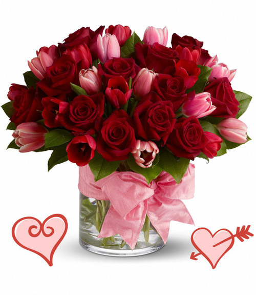 """PS I Love You Tulips for Valentines Day by Enchanted Florist Pasadena TX.  A romantic statement of love this Valentines Day. This PS I love you bouquet includes 12 classic roses, 10 pink tulips, 10 red tulips all expertly arranged in a clear cylinder tied up neatly with a beautiful pink bow.  RM941      Approx 14""""W x 13""""H"""