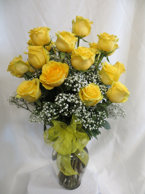 """You Are My Sunshine Two Dozen Yellow Roses by Enchanted Florist Pasadena TX. This show stopping bouquets of our lush and romantic yellow Ecuadorian roses comes complete with baby's breath, greens and a yellow bow and is hand arranged by our premier floral designers. Size is approximately 26""""H x 16""""W SKU RM370"""