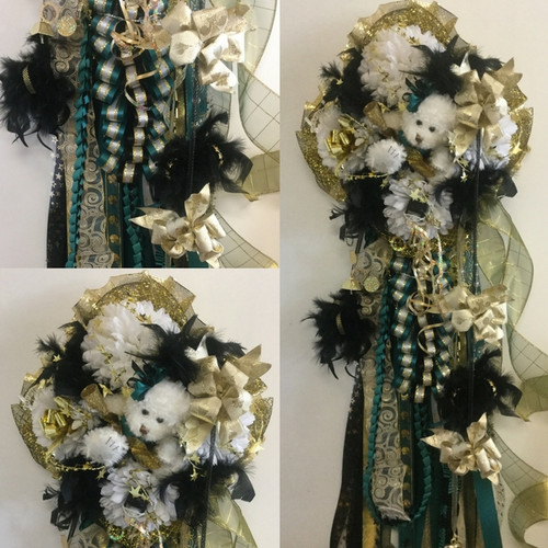 The Mumstrosity Homecoming Mum from Enchanted Florist includes four mum flowers, a spirit teddy bear, 2 braids (the Deluxe Ruffle Combo and the Deluxe Box Braid) boas, ribbons, trinkets, and decoration in the school colors of your choice.