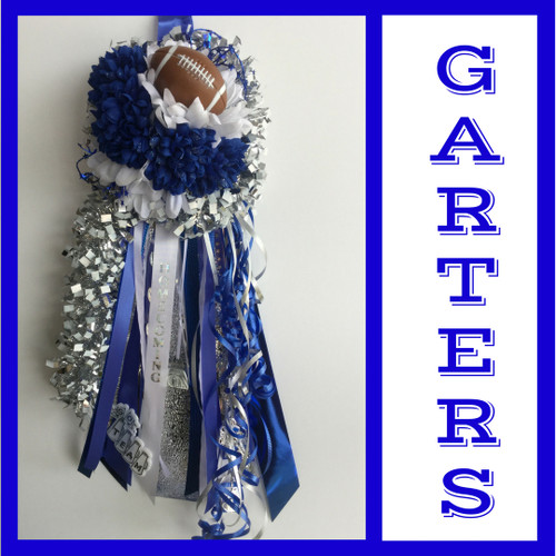 The Blue and White Homecoming Garter from Enchanted Florist includes a single garter flower, trinkets, metallic chain, and garter band in the school colors of your choice. This would be a perfect garter for Chavez High School and Friendswood High School. HMC134