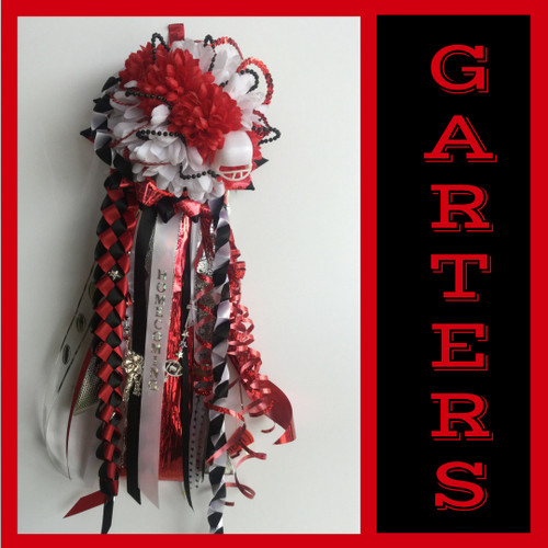 The Clear Brook High School Homecoming Garter from Enchanted Florist includes a single garter flower, trinkets, metallic chain, the Military braid, and garter band in the school colors of your choice.  HMC135