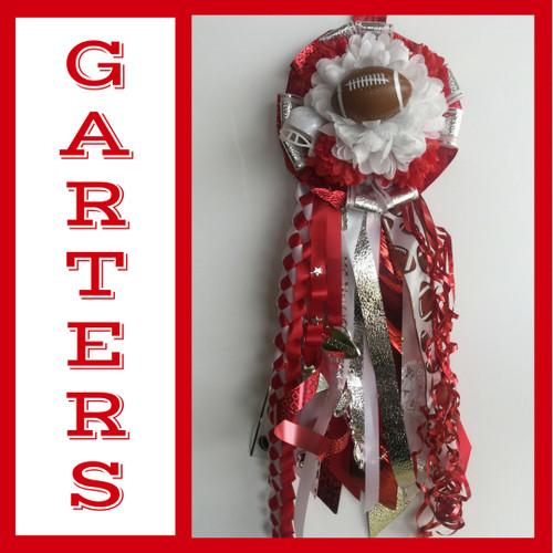 The South Houston High School Homecoming Garter from Enchanted Florist includes a single garter flower, trinkets, metallic chain, the Military braid, and garter band in the school colors of your choice.  HMC139