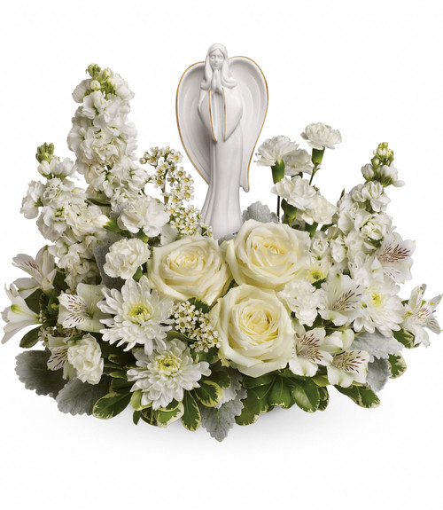 White Guiding Light Angel Flowers for Funerals by Enchanted Florist. This white angle flowers for a funeral includes white roses, white stock, white alstroemeria, white miniature carnations, white cushions and are arranged with white waxflower, and various greener for a beautiful presentation. Delivered with a white ceramic angel. SKU RM557