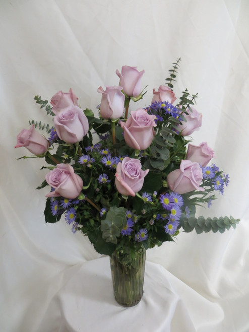 """Twilight One Dozen Purple Roses by Enchanted Florist Pasadena TX - One dozen long stems purple roses are arranged in a vase. Don't make you special someone design her own flowers from a box! Our beautiful Ecuadorean roses are hand designed by expert floral artisans. Purple rose bouquet is approximately 18""""W x 22""""H   SKU RM374"""