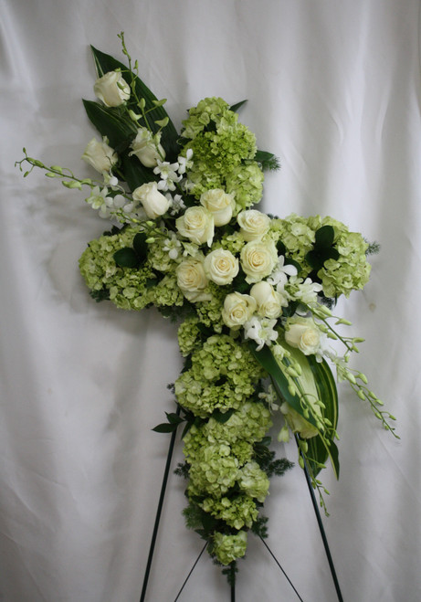 """Green Hydrangea & White Rose Funeral Cross Flowers from Enchanted Florist.  Stunning funeral flowers such as white roses, white orchids, and green hydrangeas along with carefully selected foliage create a beautiful cross that is full of love and devotion, arriving on a wire funeral easel. Approximately 223"""" W x 34"""" H  SKU RM502"""