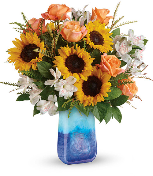 """Sunflower Beauty Bouquet in Blue Vase from Enchanted Florist. Our fun fall flower arrangement includes orange roses, white alstroemeria, and medium yellow sunflowers are professionally designed with grevillea and lemon leaf. They come hand delivered, (never in a box) in a Blue Lapis Gemstone Art Glass vase. Approximately 19"""" W x 20"""" H SKU RM224"""