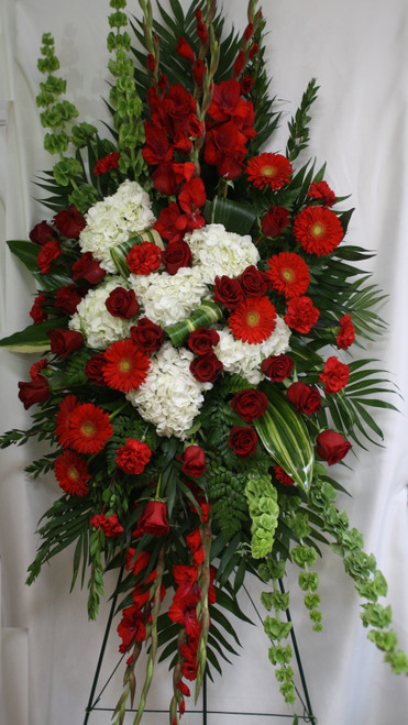 """Firelight Large Red Rose and White Hydrangea Standing Spray of Flowers from Enchanted Florist.  One of our largest sprays in reds and white, our custom spray includes red roses, red carnations, red gladiolas, red gerbera daisies, white hydrangeas and bells of Ireland, and lots of green foliage to set the design off. Approximately 70""""H x 40""""W (size not including stand) SKU RM554"""