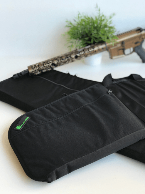 Black soft padded rifle case shown with rifle