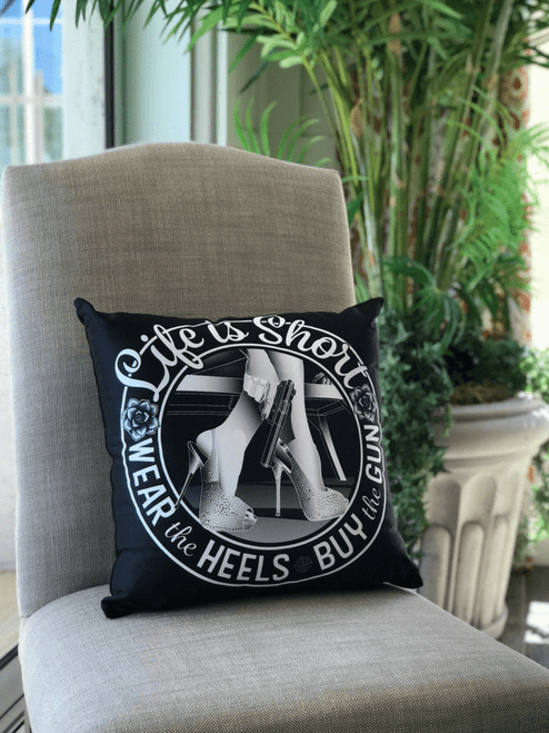 Life is Short, Wear the Heels, Buy the Gun pillow on chair