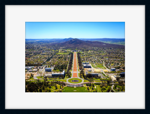 Aerial of Anzac Parade leading up to the war Memorial in a black frame
