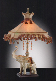A Regal Indian Elephant - Tabletop Lamp - 34.5 Inch Buffet Lamp with a French Tassel trim Umbrella Shade