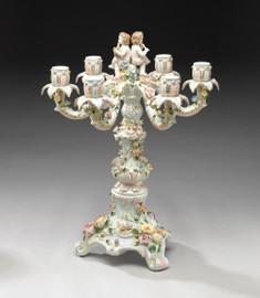 A Meissen Style Tabletop, 21.5t X 16.5w X 16.5d Porcelain Candelabrum, Cherub Motif, 6705