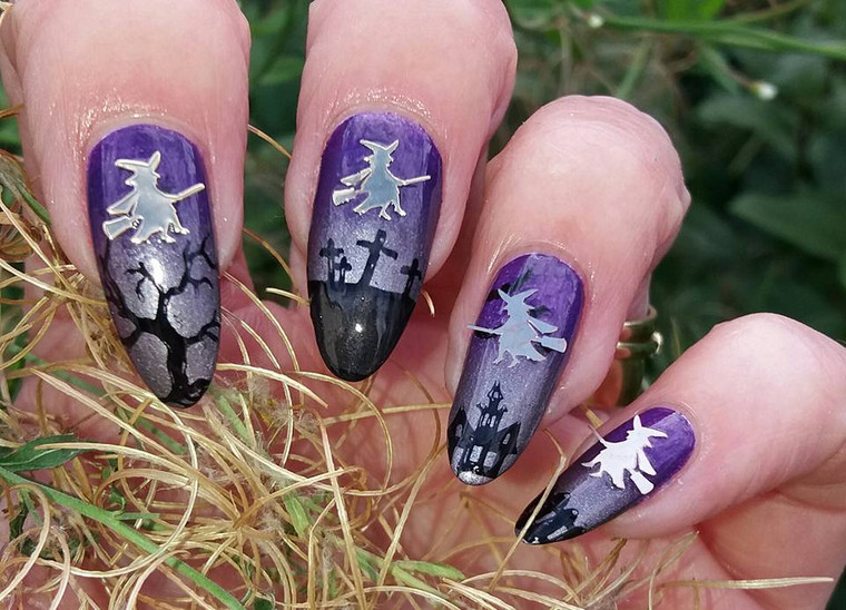 nail design featuring witches nail decals