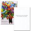 "Business birthday card Cover is Photo of balloon vendor with the text ""Happy Birthday"" Inside of card has Black lettering on white background with the text: ""Sending you all the good wishes you can hold in your arms"""