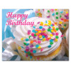 "Birthday postcard- ""Confetti Cupcakes"" with the words Happy Birthday in pink script lettering across the top of a photo of cupcakes covered with confetti candy"