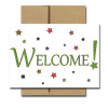 "Starry Welcome Note Card has the word ""Welcome!"" set in green type surrounded by multi-colored stars"