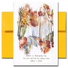 Thanksgiving card features a watercolor illustration of a road through a fall woodland and the quote: Forever on Thanksgiving Day, the heart will find the pathway home. Wilber D. Nesbit