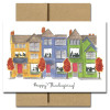 Cover of Thanksgiving Card - Good Company has a hand-drawn illustration of a row of townhouses with people visible through the windows