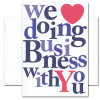 """Business appreciation card cover with the words """"we love doing business with you"""" in bright multi-colored bold letters, the word love being conveyed by an image of a big red heart"""