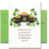 Saint Patrick's Day card shows a pot of gold surrounded by shamrocks and the saying: May your pockets be heavy and your heart be light, may good luck pursue you each morning and night.