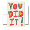 You Did It Congratulations Card has bright multi-color letters on the cover