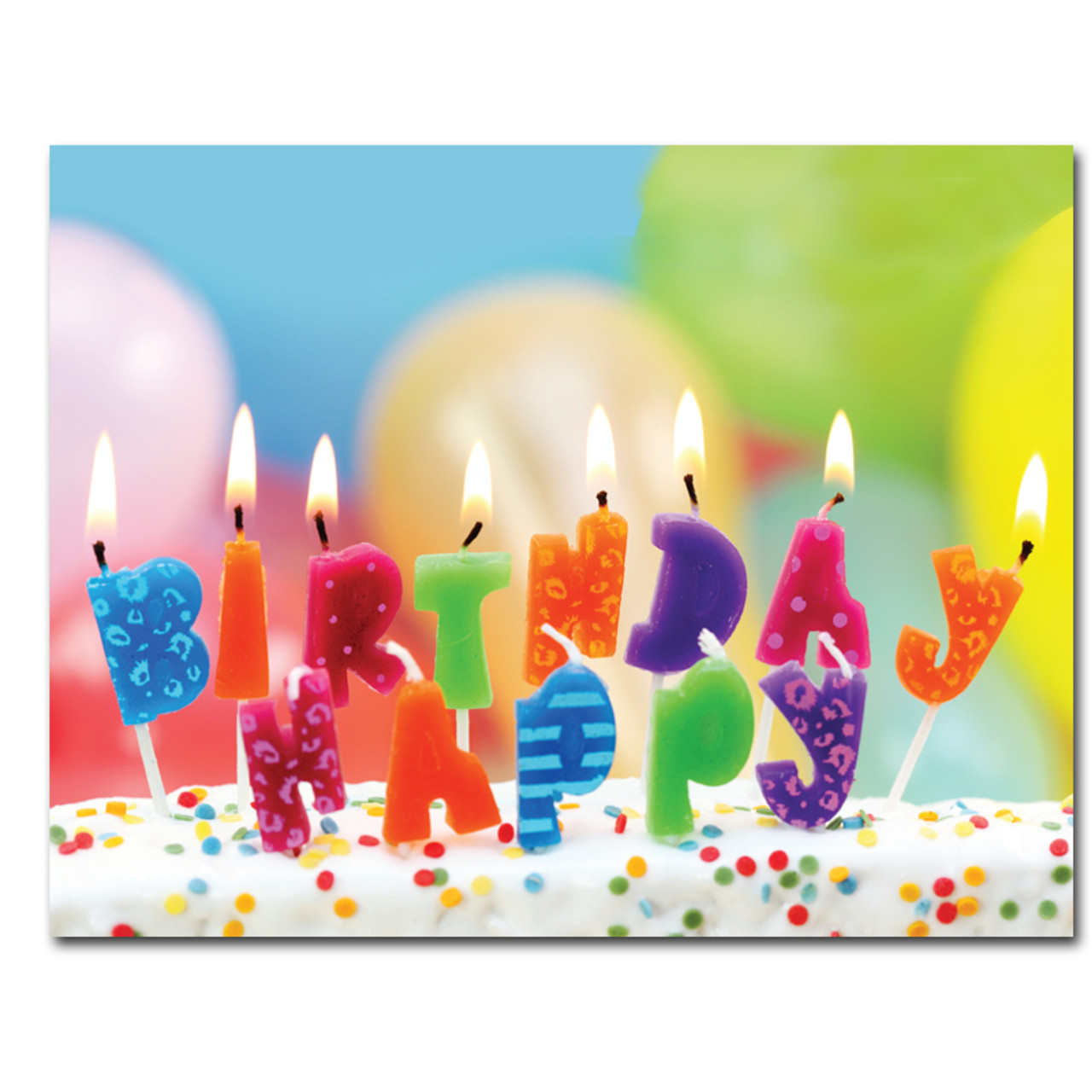 "Birthday Postcard Lighted Letters is a photo of lighted birthday candles shaped like letters, on a cake with balloons in the background, that spell out the words ""Happy Birthday""."