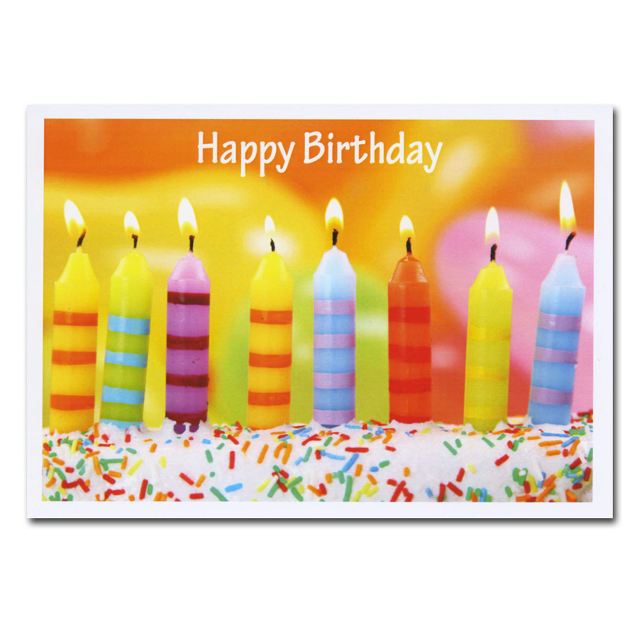 Cover of Line Up birthday card: Seven brightly colored striped candles on a cake against a backdrop of orange and yellow balloons
