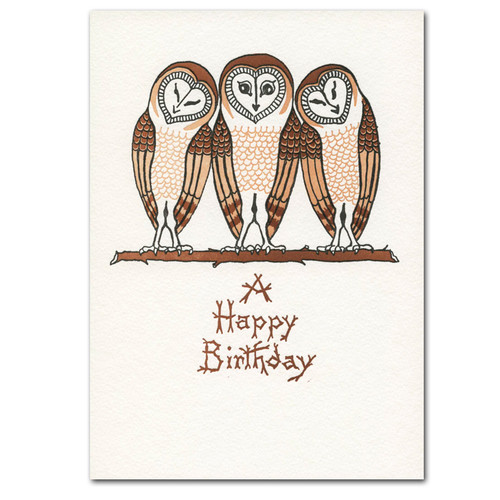 "Cover of saturn Press letterpress birthday card - three owls showing a drawing of 3 beige colored owls snuggled together on a branch with the words ""A happy birthday"" in brown letters underneath"