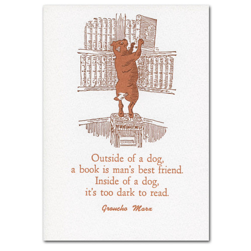 Saturn Press Letterpress Quotation Card - Book Dog.  Cover is an illustration of a dog standing on its hind legs on a stool, taking a book down from a high shelf with its front paws.  Below is a Groucho Marx quotation- Outside of a dog, a book is man's best friend.  Inside of a dog, its too dark to read.
