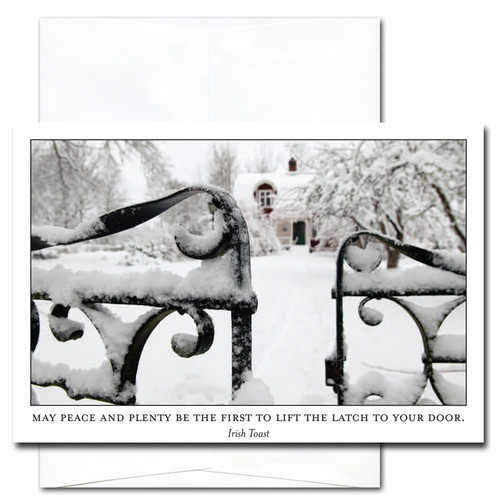 "Cover of New Year Card Peace and Plenty shows photo of slightly opened entrance gate to  snow covered yard and house with the Irish Toast ""May peace and plenty be the first to lift the latch to your door"""
