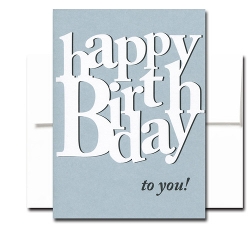 "Boxed Birthday Card - Many More has white and black lettering on a blue background and the words ""Happy Birthday to you!"""