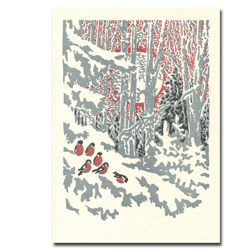 Evensong letterpress holiday card cover shows a flock of small birds feeding on the snowy ground in the forest