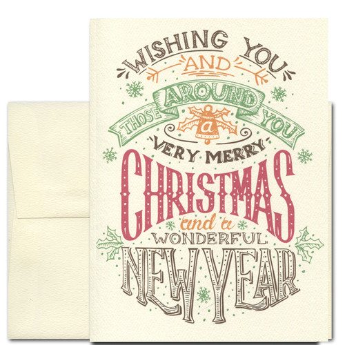 Very Merry Holiday card has a vintage hand-lettered design that reads: Wishing you and those around you a very Merry Christmas and a wonderful New Year