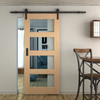 simple black barn door hardware with glass panel